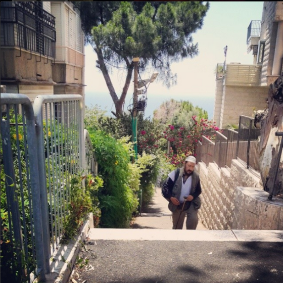 HaRav Yosef Dana steps with view of the Mediterranean, Haifa